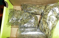 Four-ounce bags of marijuana. Photo from Wikimedia Commons.