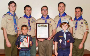 Five of the six Gemmell Eagle Scouts pose with county proclamation and their younger siblings. Photo courtesy of Becky Gemmell via County News Center