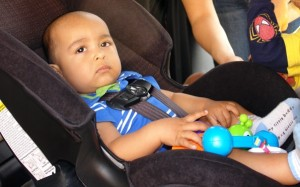 A child properly protected in a car seat. Photo courtesy County of San Diego.