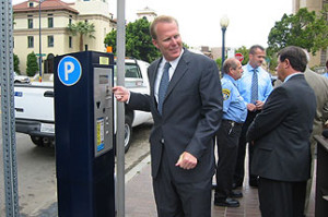 A form of parking meter that accepts credit cards. San Diego will consider more wide spread use of such meters. Pictured: Incoming Mayor Kevin Faulconer.