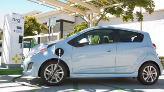 A Chevrolet Spark EV recharges at Fashion Valley Mall. Photo by Stan Liu for Chevrolet