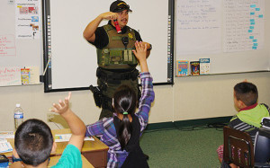 Sheriff's Deputy Mike Astorga teaches kids to resist gangs and also works on the Sheriff's Gang Enforcement Team. Photo via County News Center