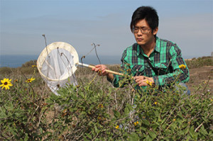 UCSD doctoral student James Hung in the field. Photo courtesy UCSD News Center