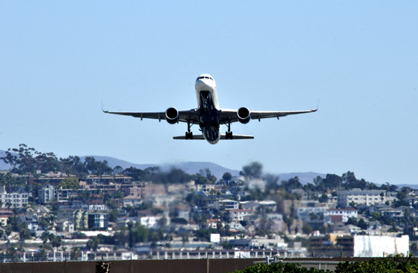 Airplane takes off from Lindbergh Field.  Photo by Chris Stone