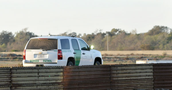 Border Patrol agent monitors U.S.-Mexico border.  Photo by Chris Stone