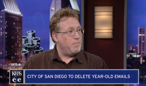 Attorney Cory Briggs, opponent of email deletion policy, speaks on KPBS. Image from KPBS via YouTube.com