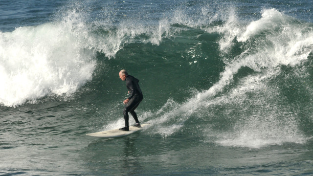 Surfing at La Jolla's Windansea Beach.  Photo by Chris Stone