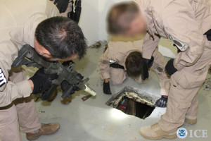 Law enforcement officials inspect smuggling tunnel in Otay Mesa. Photo courtesy ICE