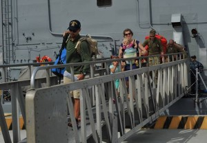 The Kaufman family arrives in San Diego after being rescued at sea and brought home by the Navy. Photo by US Navy.