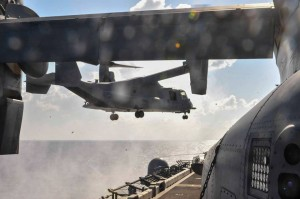 An MV-22 Osprey lands on the flight deck of the amphibious assault ship USS Boxer in the Jan. 22 photo released by the Navy.  U.S. Navy Photo by Mass Communication Specialist 3rd Class J. Michael Schwartz.