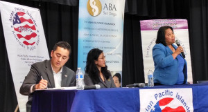 City Council candidate Mitz Lee speaks while Carol Kim listens and Chris Cate takes notes. Photo by Chris Jennewein