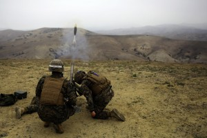 Marines at Camp Pendleton fire a mortar. Photo by Cpl. Orrin G. Farmer