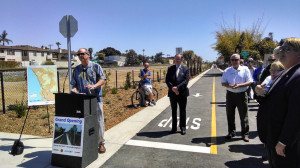 Imperial Beach Mayor Jim Janney, left, and Oceanside Mayor Jim Wood, center, at the ribbon cutting for a portion of the Oceanside Coastal Rail Trail. Photo by Chris Jennewein