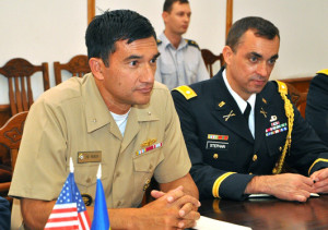 Rear Adm. Patrick Piercey (left) met with Moldovan officers in August 2013. Photo via army.md