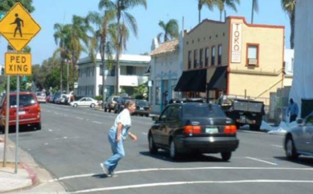 Pedestrian running across a street