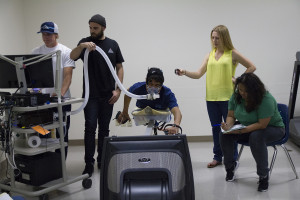A research participant at California State University San Marcos simulates paddling on a swim bench modified with a surfboard. Photo courtesy of the university