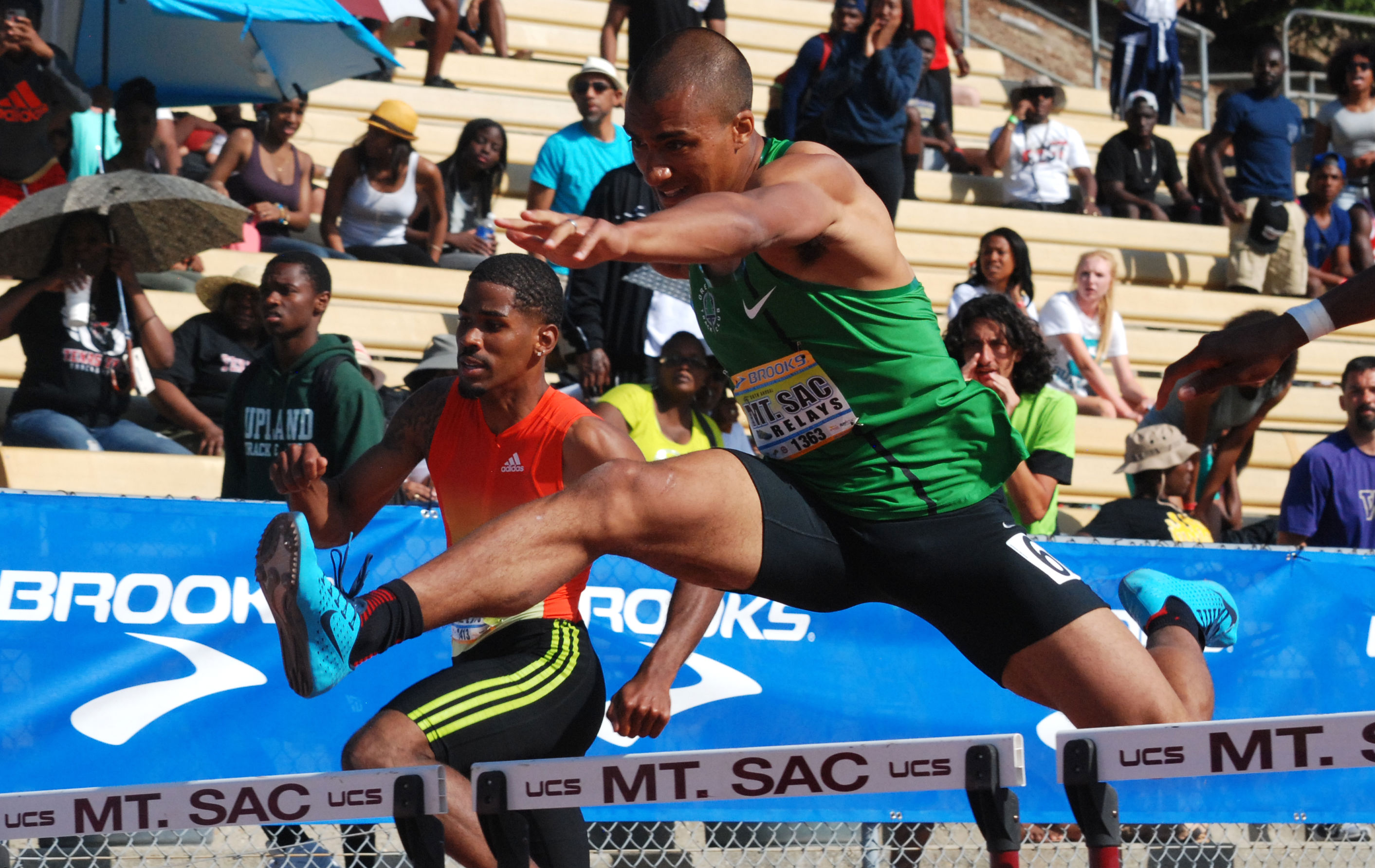 Ashton Eaton clears last 36-inch barrier in his long-awaited debut at the 400-meter hurdles at the Mt. SAC Relays on April 19, 2014. Photo by Ken Stone