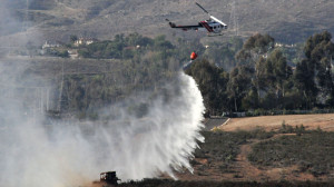 A Cal Fire helicopter drops water Tuesday. Photo by Chris Stone