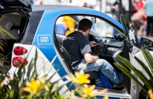 A man test driving an electric car at the 2013 energy expo. Photo courtesy SDG&E
