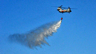 Multiple helicopters made water drops over San Marcos hillsides.