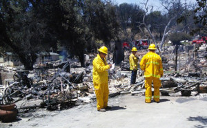Crews assess fire damage in San Diego County. Photo via County News Center