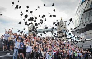 Listed Guinness world record for tossing mortarboards at same time is held by a London group in 2012. Photo via guinnessworldrecords.com