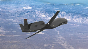 A Northrup Grumman RQ-4 Global Hawk flying over mountains and desert. Photo courtesy Northrup Grumman