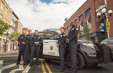 San Diego Police officers with cruiser. Photo courtesy San Diego Police Department