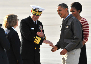 President Obama gives Vice Adm. Rick Hunt the challenge coin after arrival at North Island Naval Air Station on Nov. 11, 2011. Photo by Chris Stone
