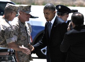 President Obama hands challenge coin to Marine commander at Miramar stop on May 8, 2014. Photo by Chris Stone