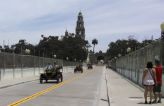 A caravan of classic cars crosses the reopened Cabrillo Bridge. Photo by Chris Jennewein