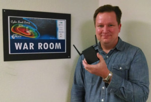 ESET's Cameron Camp holding a device that can be used to break into wireless networks. Photo by Chris Jennewein