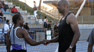 NFL Hall of Famer and masters sprinter James Lofton congratulates Carmelita Jeter after her 100-meter race at Mesa College. Photo by Chris Stone