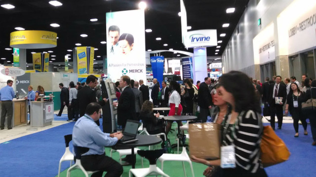 Crowds enter the BIO exhibit hall near the California booth in 2014. Photo by Chris Jennewein