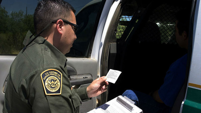 A Customs and Border Protection agent makes an arrest. Photo courtesy Department of Homeland Security