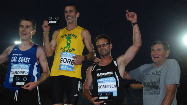 Winner Tim Gore, runner-up John Gardiner and third-placer Jim Sorenson posed with Jim Ryun after masters men's race.
