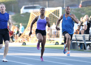 Carmelita Jeter, in lane 5, races men at San Diego Mesa College. Photo by Chris Stone