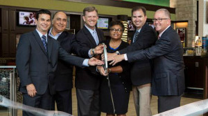 Thella F. Bowens (center), President & CEO of the San Diego Airport Authority, lead a ribbon cutting for the PGA Tour Grill.