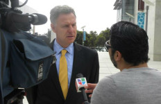 Scott Peters interviewed by a television reporter. Photo courtesy Peters' office