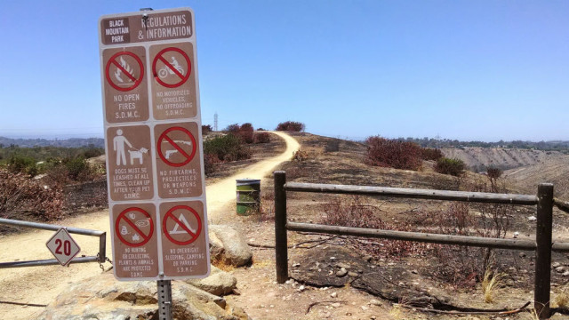 The charred area at a trailhead in Black Mountain Park. Photo by Chris Jennewein