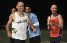 Brad Barton is cheered the last 10 yards of race by San Diego Track Club's Alan Olson.