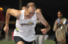 Brad Baron sets off on world record mile attempt at Olympian High School