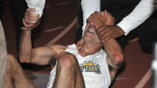 Brad Barton reacts to confirmation that he missed age-group world record in the mile by 1.5 seconds.