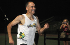 Brad Barton guts out final yards of mile in 4:17.54 at Olympian High School.