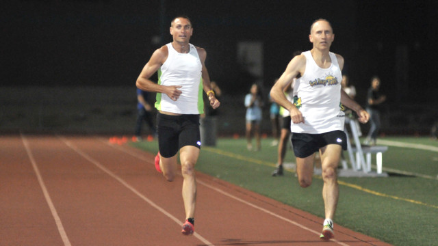 Brad Barton (right) was paced by sub-4 miler Darren Brown of San Diego.