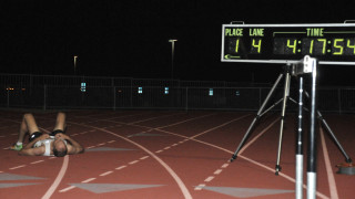 Clock shows Brad Barton was 1.5 seconds off age-group world record in mile.