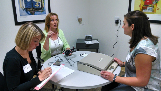 Students and faculty test equipment prior to the clinic's official opening. Photo by Chris Jennewein