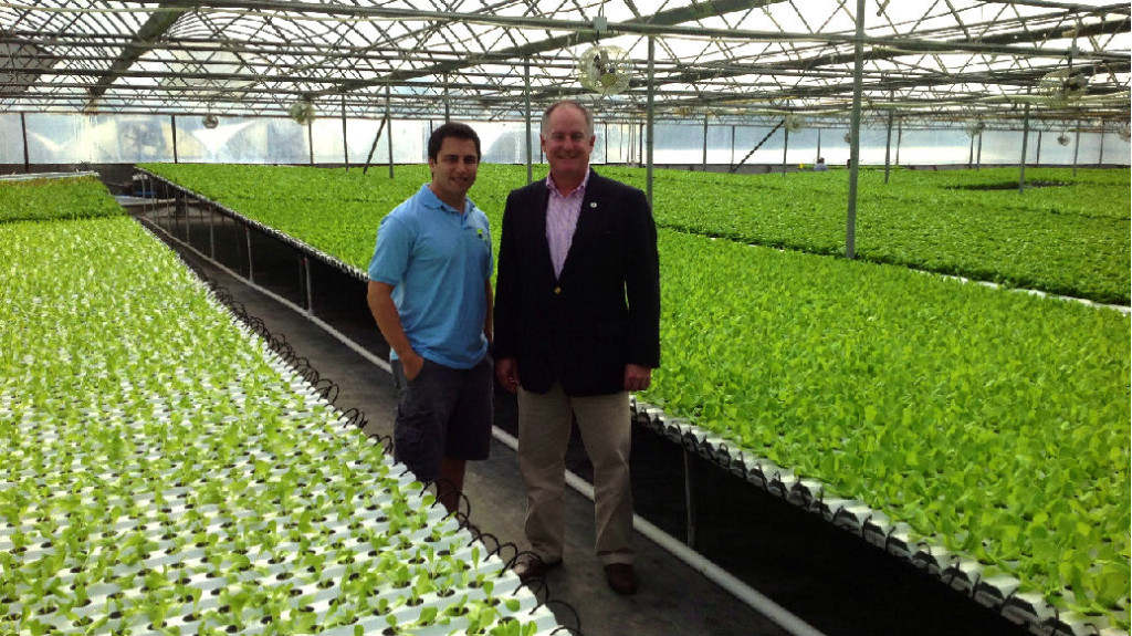 Pierre Sleiman, left, in a greenhouse with Val Dolcini, California director of the U.S. Department of Agriculture. Photo courtesy Go Green Agriculture