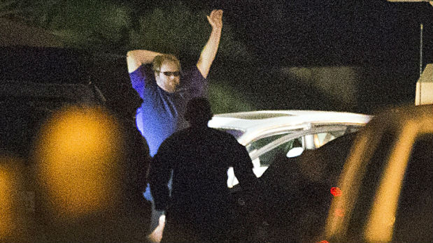 Ronald Lee Haskell Jr. surrenders to police. Photo via Wikimedia Commons
