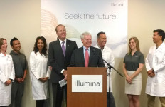 Illumina CEO Jay Flatley, center, with Mayor Kevin Faulconer, left, and company employees. Photo by Chris Jennewein